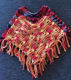 Children's size barn poncho.  Pattern is for 3 years and 5 years.