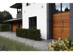Houten garagedeuren - De Goeij Deuren
