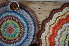 Homemade crocheted rugs in pretty colors, simple patterns