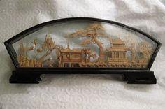 Vintage Cork Carving Framed in a Lacquer Shadow Box.. $39.00, via Etsy.