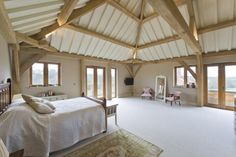 Green oak roof with painted rafters to bedroom in Country House in Hampshire