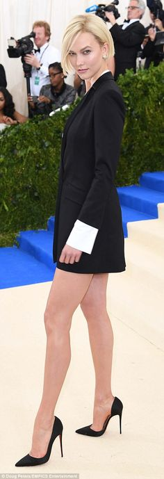 Stunner: The 24-year-old showed off her long lean legs in the black and white number that skimmed the top of her thighs paired with black pointed-toe stiletto heels
