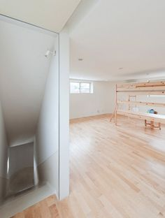 Japanese studio Level Architecs have completed a house in Tokyo, Japan, with a slide connecting all three floors.