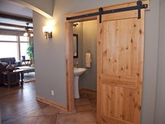 I love these sliding doors in the Lund Builders 2012 Tour model home.    www.lundbuilders.com  #creative doors, #home ideas, #interior design #rustic home