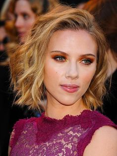 Scarlett Johansson's textured bob and orange eyeshadow | allure.com
