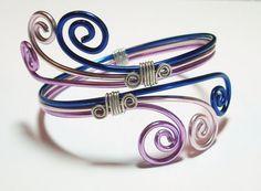Three-colored wire swirls make up an anodized aluminum bypass style bangle bracelet -  pattern #3 photo