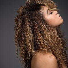 Curly blonde. Curly Afro blonde. Blonde color on natural hair. Afro curls with color.