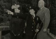 A policewoman models the newly authorized uniform for a police commissioner and Police Chief Clarence Horrall in 1948. Photo courtesy of the Los Angeles Police Historical Society.