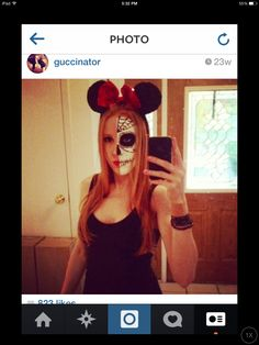 My makeup from last halloween. Half sugar skull mini mouse