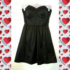 SUPER SEXY LITTLE BLACK DRESS Super short bottom is flowy. Great for Valentine's Day. Never worn. Padding in top. Shiny soft beautiful fabric. Dresses Mini