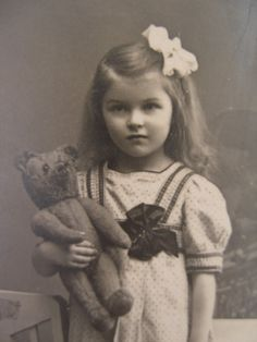 Edwardian girl with a teddy bear