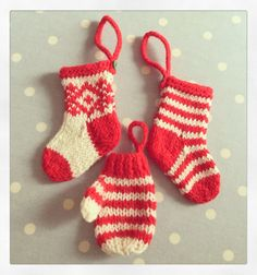 Knitted mini Christmas stockings and mittens! Stocking pattern from http://littlecottonrabbits.typepad.co.uk/free_knitting_patterns/