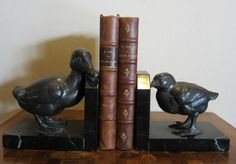 ANTIQUE French ART DECO book ends bookends duck and chick, rare pair!! ca 1920 by ElflingAntiques on Etsy https://www.etsy.com/listing/194482442/antique-french-art-deco-book-ends