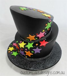 This topsy turvy cake was based on the clients design made to match her party decor theme – being black with rainbow coloured stars. This cake cat. Topsy Turvy Cascade of Stars Cake Beautiful Cakes, Amazing Cakes, Fondant Cakes, Cupcake Cakes, Neon Cakes, Star Cupcakes, Snowman Cake, Engagement Cakes, Cool Wedding Cakes