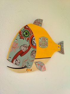 Fish made with Wood, Metal,Glass, Handmade by Unikos Arts Give your wall a upcycled beach steampunk theme with one of a kind original distressed Fish wall art sculpture. Hanging point provided at back for ease of wall hanging Dimensions D x W x H 9 in Fish Wall Art, Fish Art, Greek Flag, Steampunk Theme, Seaside Art, Fisherman Gifts, Fish Sculpture, Beach House Decor, Coastal Decor