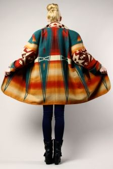 I love this Native American blanket coat. The beautiful mix of colors and the triangular patterns have given this coat a unique beauty.