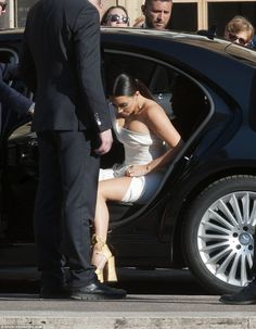 Best foot forward: As they arrived, Kim carefully exited her car in her thigh-slash number