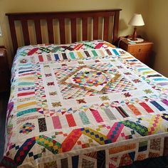 """#possummagicquilts #roundrobin quilt on a Queen sized bed. It's 87"""" square"""