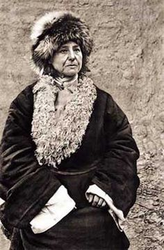 "Described as ""the 20th century's most footloose traveler,"" Alexandra David-Néel (1868-1969) saw a lot in her 100 years.  She crossed the Alps, cycled through Europe (when bikes were wild and new), and studied Hinduism in India and Buddhism in China. She left her husband for Tibet and then returned home to France after 14 years, where she built a Tibetan-style fortress and wrote some of the most essential travel books ever. As she approached 70, she went back on the road."