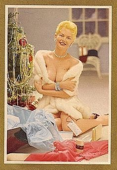 Janet Pilgrim on a 1950s Playboy Christmas card.; it says I'm both classy and easy.