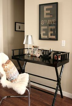 Gorgeous small office area with glossy black faux bamboo desk from Indonesia, Ikea Tobias Chair with Ikea pelt, Jonathan Adler Pillows and subway sign.