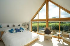 Bedroom a-frame Design Ideas, Pictures, Remodel and Decor. I'd have to place my bed against the wall of my A frame, glad to see it working well in this room pictured