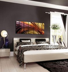 Contemporary Bedroom Decor - #Abstract Metal Wall_Art over the bed adds a pop of color