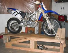Wood motorcycle lift table plans not going to get too for Motorcycle garage plans