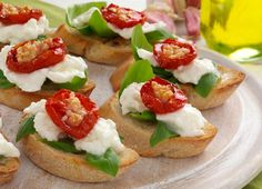 Tomato And Fresh Basil Crostini With Feta And Roasted Garlic Cheese ...