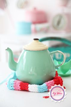 Cute minty teapot. Actually, I like the dishcloth.