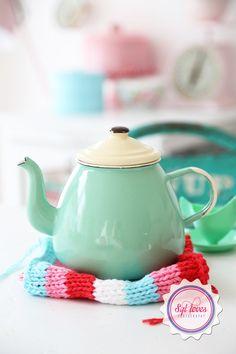 Cute minty teapot. Actually, I like the dishcloth.