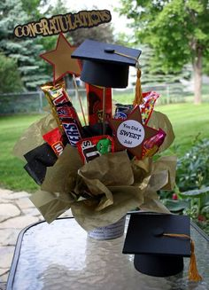 Graduation-themed candy bouquet. Great gift for upcoming grads! I'm probably going to include a card with graduation money for Patrick.: