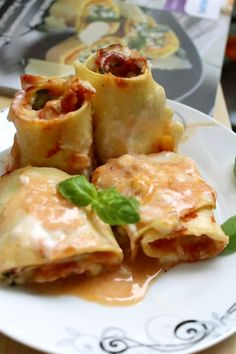 Rollè di lasagne con rucola, salumi e mozzarella