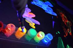 Tot Treasures: Exploring sight with a little black light! Glow in the dark painting. You need a black light.