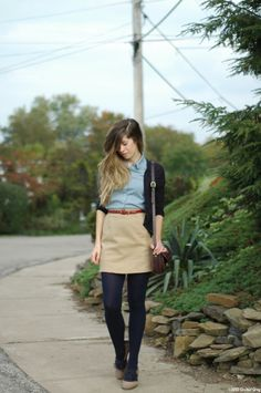 Easy to recreate.  Khaki skirt, chambray button-down, navy cardigan, navy tights.