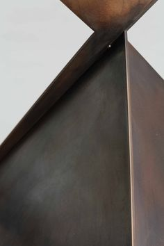 Details from our Ava table bronze base