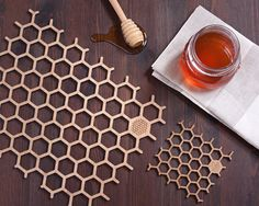 Set of four naturally finished bamboo honeycomb place mats & drinks coasters (4 place mats & 4 coasters).    Product Dimensions: 27.5cm x 21cm x 0.4cm