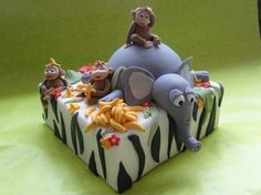 Jungle Theme.  Really sweet single tier child's cake with a zebra print, monkey, bananas and topped with a sleepy elephant.