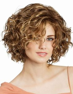 Haily Wig by Tony of Beverly. A modern, punchy bob with loose ringlets all over that will make your look sizzle this summer! The side swept bangs on a RTW LaceFront curl away from the face and elevate the total look. This wig is an easy shake and go, ready to be the next knockout success