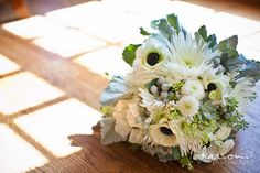 A silver, white and green bouquet with Anemones
