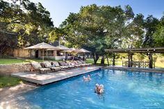Formerly the family home of Singita founder Luke Bailes' grandfather, Singita Castleton is an exclusive use lodge set within acres of private reserve. Field Guide, Maine House, Rustic Chic, Lodges, Living Area, Acre, South Africa, Swimming Pools, Restoration