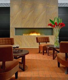 Gas fireplace with rock.