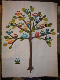 Woodland Owl Quilt with lots of hoots in a tree with dotted leaves and an owl on a swing. $325.00, via Etsy.