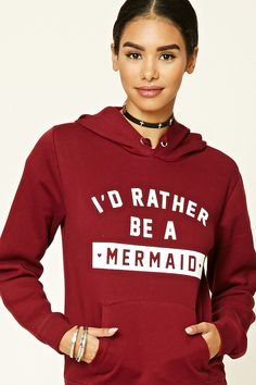 """A knit hoodie with a front """"I'd Rather Be A Mermaid"""" graphic, long sleeves, a drawstring hood, and a front kangaroo pocket."""