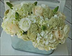 hydrangeas, Star of Bethlehem, ranunculus, 'Vendela' roses and rice flower in a galvanized oval tin