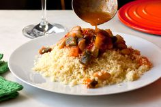 Couscous with Stewed Tomatoes, White Beans, Squash and Peppers.