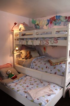 Christmas Bedding- triple bunk bed in girls room with their cozy PBKids Christmas duvets.