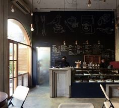 Birdsong Cafe - Concrete floor and chalkboard graphics. neutral color scheme.