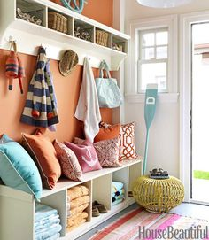 If I can't buy  full mud room storage furniture, I will do something like this.