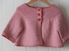 Alicia Paulson (posie gets cosy), pink baby sweater - love the blanket stitch detail around the hems!
